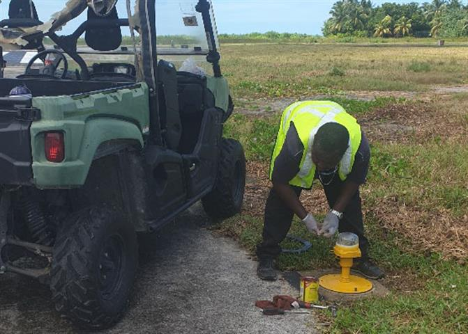 An electrical staff working on the airfield lighting